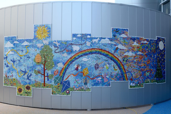 mosaic mural with rainbow and kites